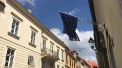 European and Greek flag in the old town of Zagreb Stock Footage