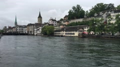 The Limmat river with the St. Peter and Fraumünster in Zurich Stock Footage