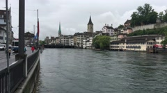 The Limmat river with a lot of water and the St. Peter Stock Footage