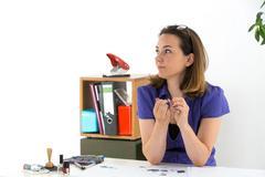 Bored secretary polishing nails instead of working Stock Photos