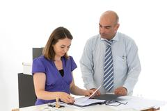 Business people checking legal documents in office Stock Photos
