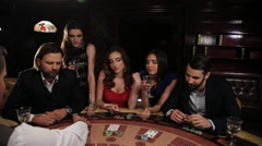 Elegant man and woman gambling at the casino. friends playing blackjack - stock footage