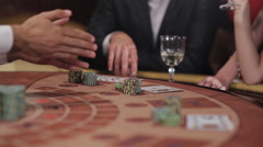 Playing blackjack in the casino. People make bets and win. - stock footage