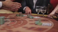 Playing blackjack in the casino. People make bets and win. Stock Footage