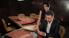 Couple makes a big bet in blackjack in casino - stock footage