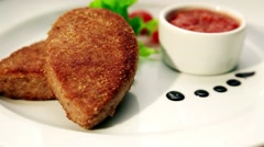 Appetizing cutlet on a white plate - stock footage