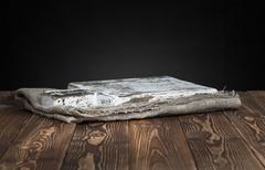 Dark background for product montage. Old wooden cutting board. Stock Photos