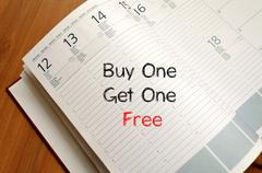 Buy one get one free write on notebook Stock Photos