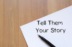 Tell them your story write on notebook Kuvituskuvat