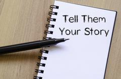 Tell them your story write on notebook - stock photo