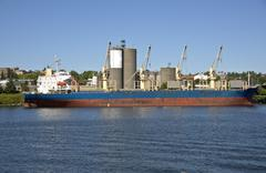 A cargo ship on the Willamette river Portland Oregon. - stock photo