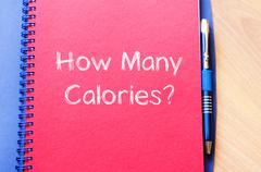 How many calories write on notebook - stock photo