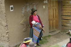 View of a Native peruvian woman and her baby, Paru Paru Community - stock photo