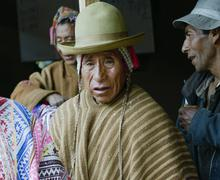 Portrait of a Native Peruvian man wearing typical andean robe - stock photo