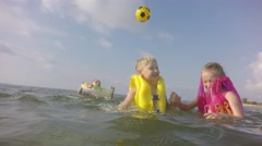 Group of children playing in the sea.  Moving the camera. - stock footage