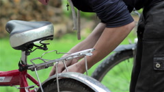 Bicycle brake repair man Stock Footage