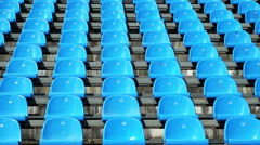 Sport stadium seat no people sitting on blue chairs backgrounds Stock Footage