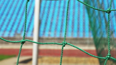 View of the stadium through the net of football gate Stock Footage