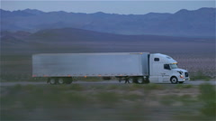 CLOSE UP: Freight semi truck driving and transporting goods on empty highway - stock footage