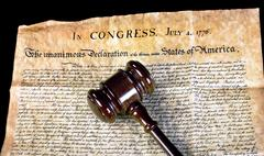 American Declaration of Independence and wooden gavel. Stock Photos