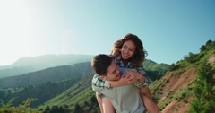 Happy Couple Having Fun Outdoors in the background mountains sunset time,slow Stock Footage