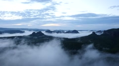 Majestic peaks cut lighting mist. Deep valley is full of fog and rocky hills Stock Footage