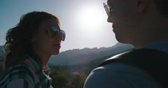 Couple Enjoying the sunrise in the mountains, love scene, slow motion Stock Footage
