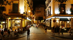 Time lapse view of tourists getting dinner in Sevilla, Spain Stock Footage