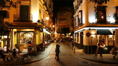 Real time shot of tourists getting dinner in Sevilla, Spain Stock Footage