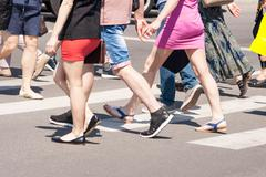 pedestrians cross the road - stock photo