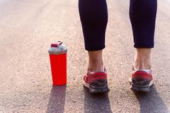 Skillful male runner stands near drink Stock Photos