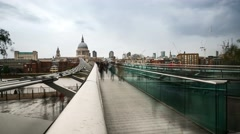 Timelapse of Tourists crossing Millenium Bridge in London Stock Footage