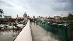 Timelapse of Tourists crossing Millenium Bridge in London - stock footage