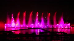 Dancing colorful fountains at night Stock Footage
