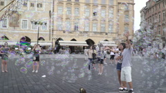Man make a Flying soap bubbles in Old Town Square Prague 125fps Stock Footage