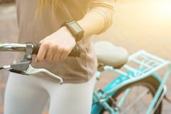 Cheerful girl entertaining with bike - stock photo