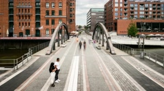 Pedestrians crossing Busanbruecke in Hamburg, HafenCity in timelapse Stock Footage