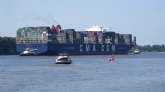 CMA CGM Jules Verne Containership leaving Hamburg Harbor Stock Footage