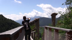 Tourist takes picture of the Earth Pyramids from the viewpoint Stock Footage