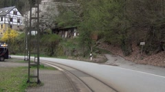 Old two-car yellow tram arrives to the Mittelndorfer Mühle stop Stock Footage
