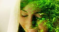 Girl face DE green grass Stock Footage