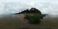 360Vr Video Man on the Sandy Bank of the River Spherical Panorama View on the Stock Footage