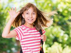 Girl back to school - stock photo