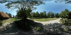 360Vr Video Tourist Walking by Dusty Crossroad Tree Behind Palisade Cottages Stock Footage