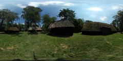 360Vr Video Man Taking Photos of Huts Reed Roof Old Village Observing Rustic Stock Footage