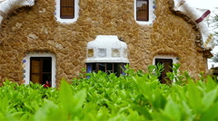 Ceramic tiles and houses in Antoni Gaudi's Park Guell, Barcelona, Spain Stock Footage