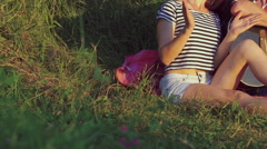 Two girl with funny boy rejoicing with guitar in the sunny park. Slow motion - stock footage