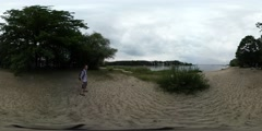 360Vr Video Man Tourist on Sandy Bank of River Sea Green Bushes Trees Grow on a Stock Footage