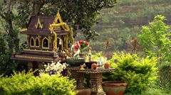 Thailand Spirit House ,San Phra Phum, Rean Tevoda, Pteah Phum, in Green Stock Footage