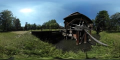 360Vr Video Man Walking by Bridge Water Mill Old Village Tourist is Observing Stock Footage